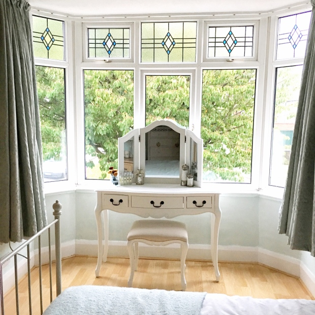 My white shabby chic dressing table in the bay window of our bedroom